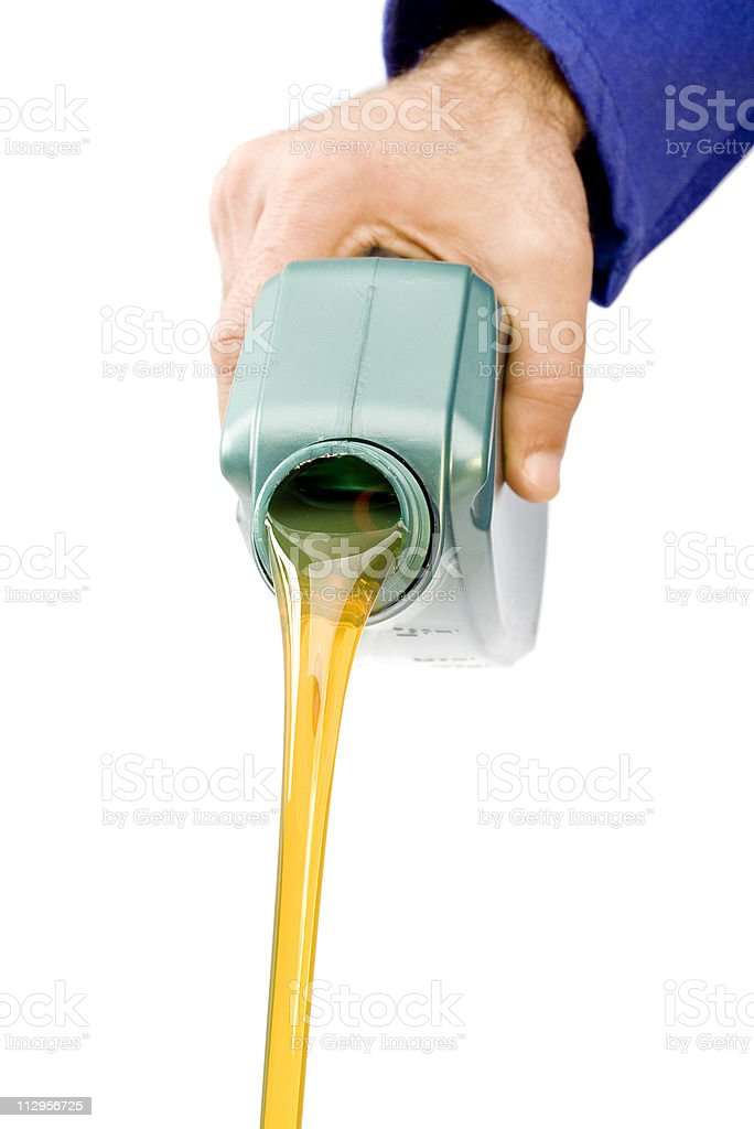 Hand pouring motor oil royalty-free stock photo