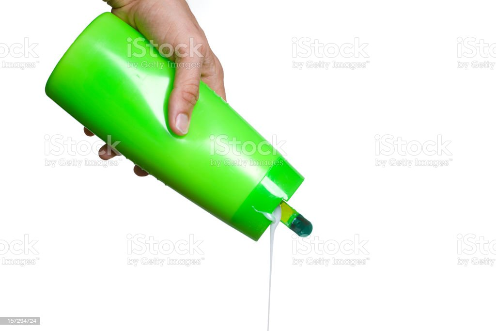 Hand Pouring Shampoo stock photo