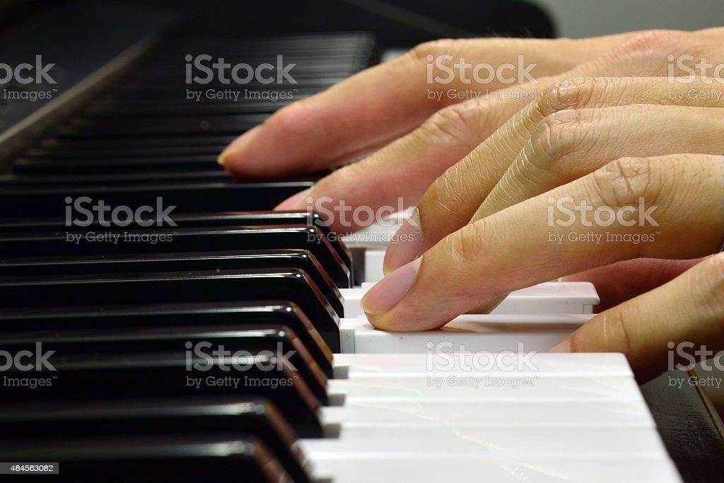 Hand practicing piano stock photo