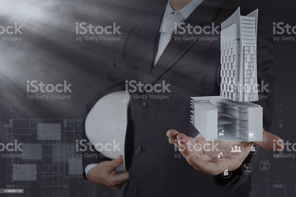 hand presents building development as concept royalty-free stock photo