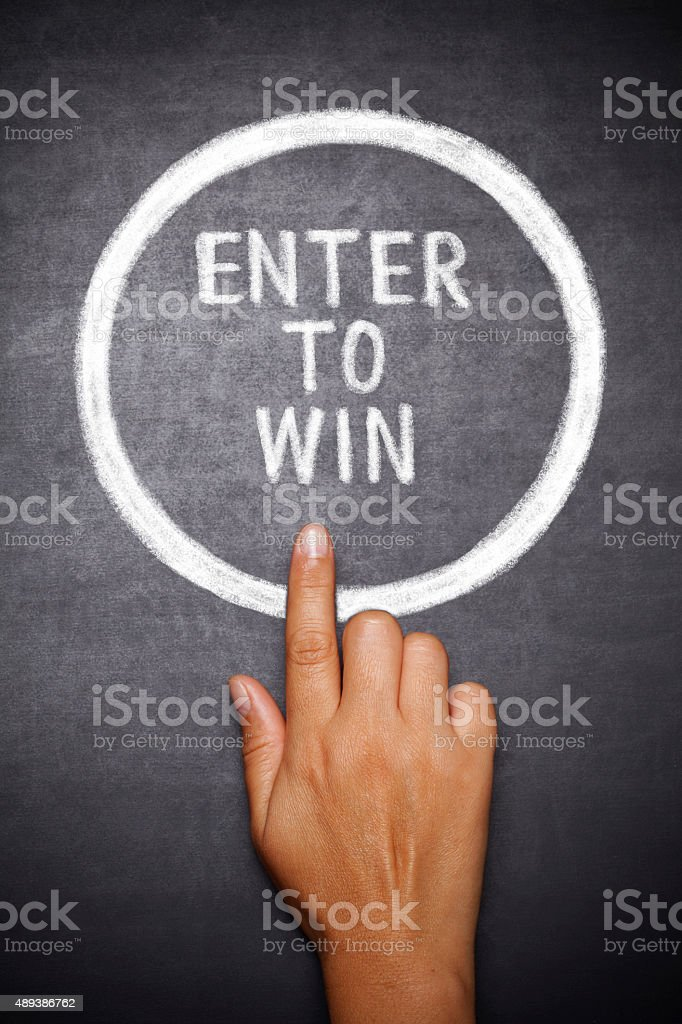 Hand  press  button ,, Enter to win ' stock photo