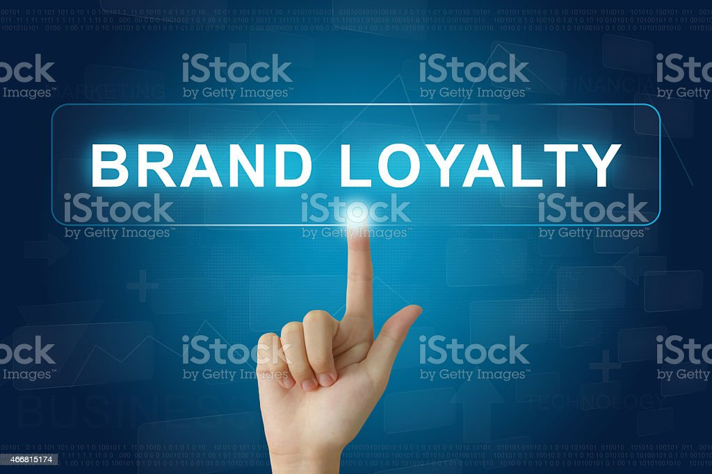 hand press on brand loyalty button on touch screen stock photo