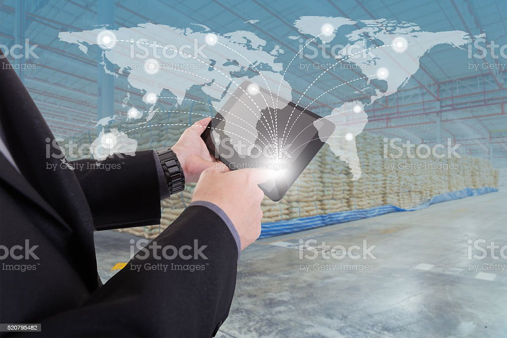 hand presses on world map with digital tablet stock photo