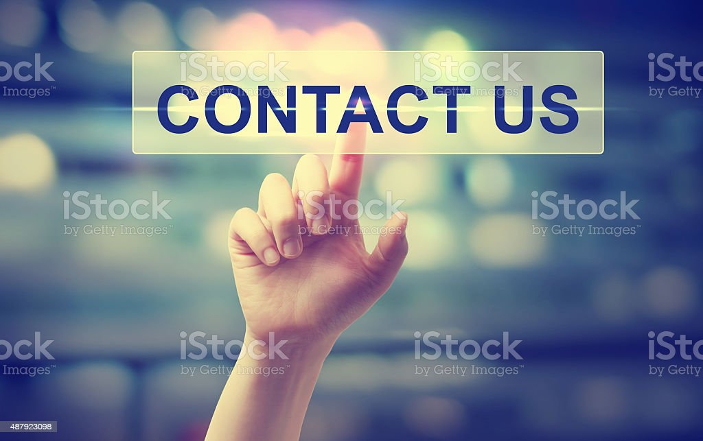 Hand pressing a contact us button stock photo