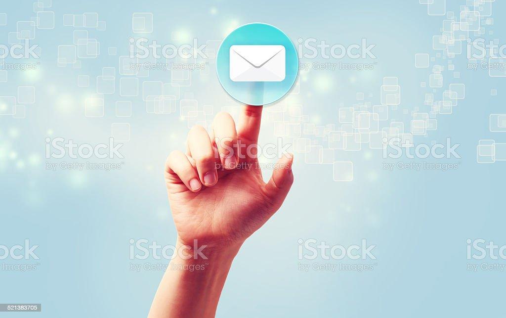 Hand pressing a envelope icon stock photo