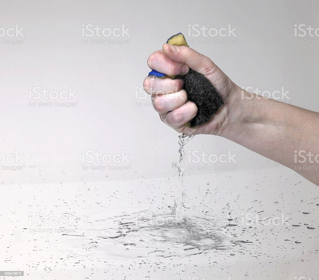 hand pressing a wet sponge royalty-free stock photo