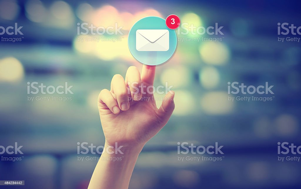 Hand pressing an email icon stock photo