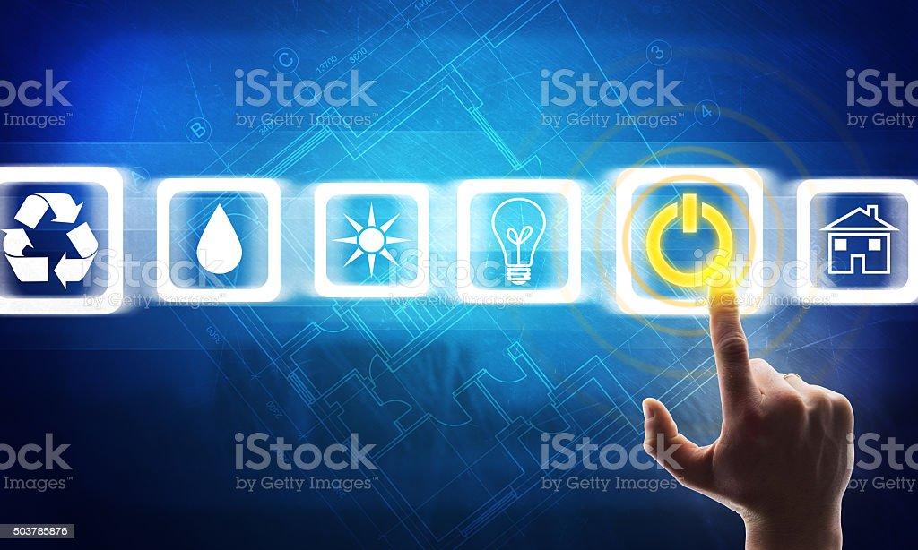 Hand pressing blue virtual button stock photo