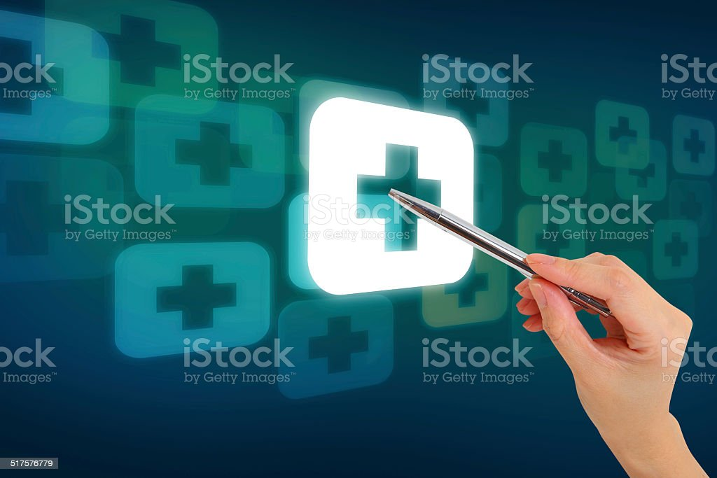 Hand pressing button with first aid sign stock photo