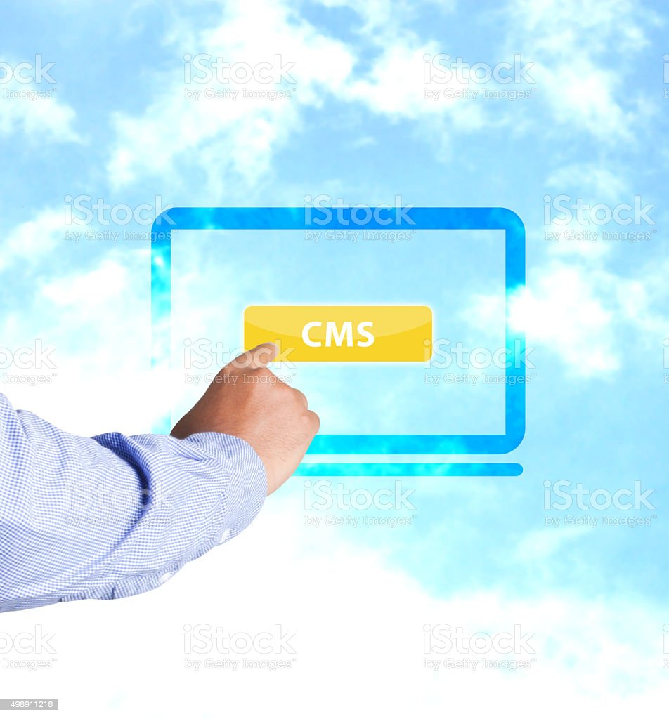 Hand pressing CMS button stock photo