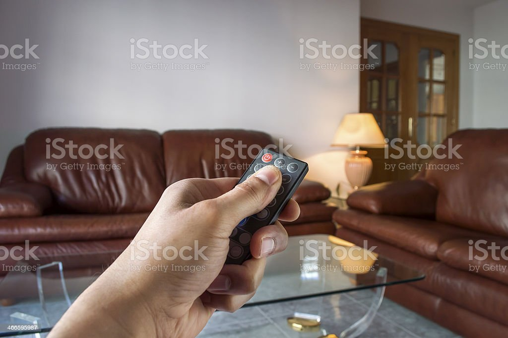 hand pressing control remote a lamp stock photo