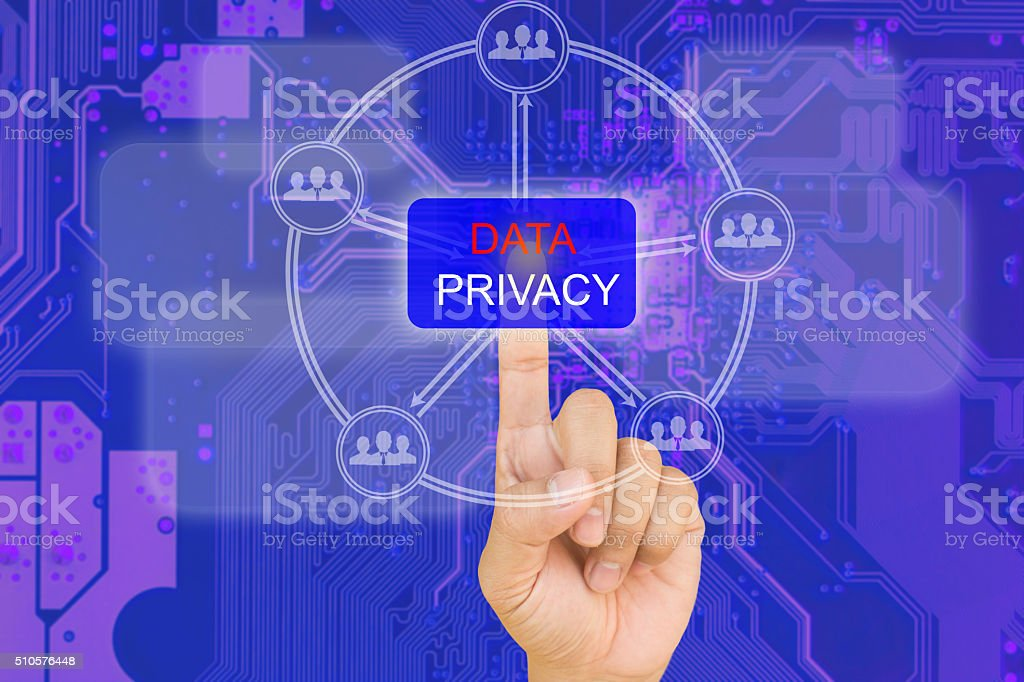 hand pressing data privacy button on interface stock photo