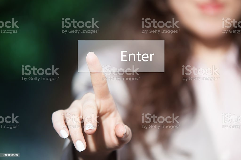 Hand pressing enter button on touchscreen. stock photo