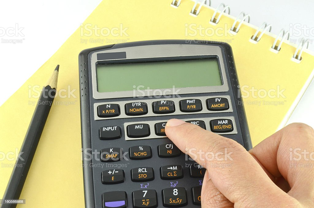 Hand pressing financial calculator royalty-free stock photo