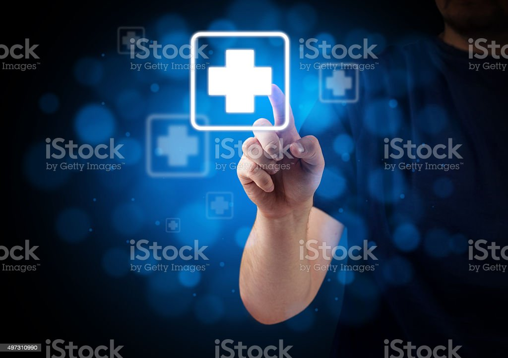 Hand pressing First Aid Button on virtual keyboard stock photo