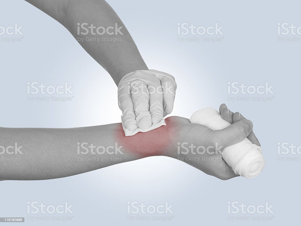 Hand pressing gauze on arm after administering an injection. royalty-free stock photo