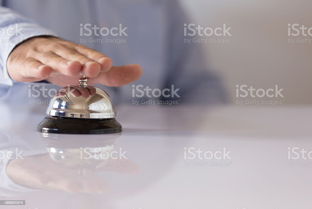 Hand Pressing Hotel Bell stock photo