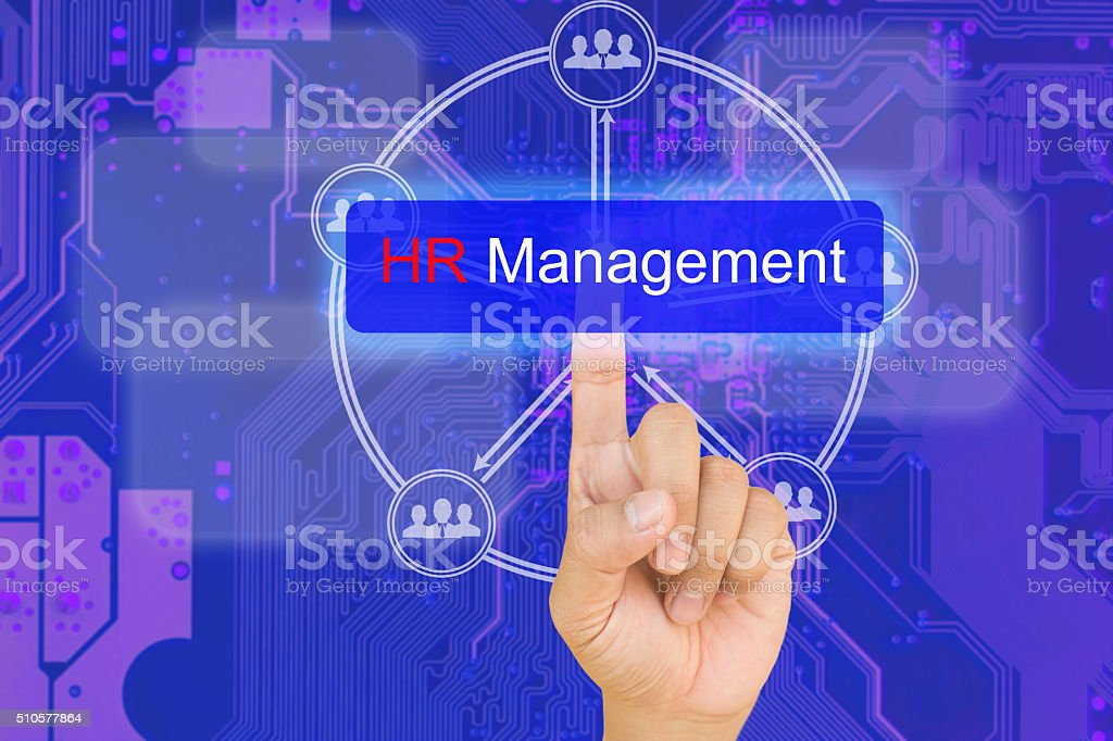 hand pressing HR management button on interface stock photo