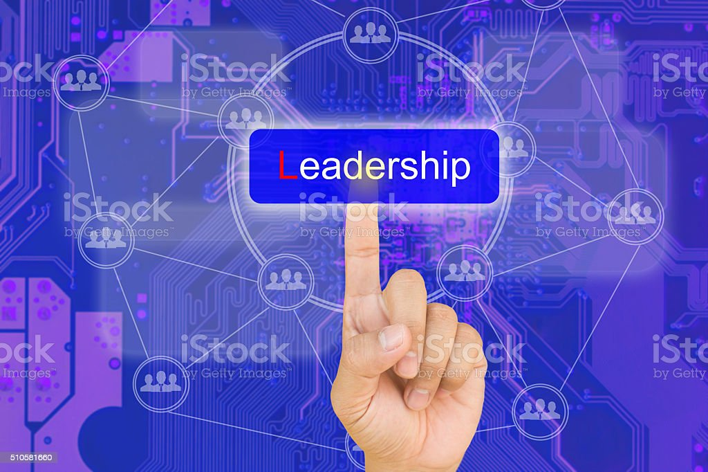 hand pressing Leadership button on interface stock photo