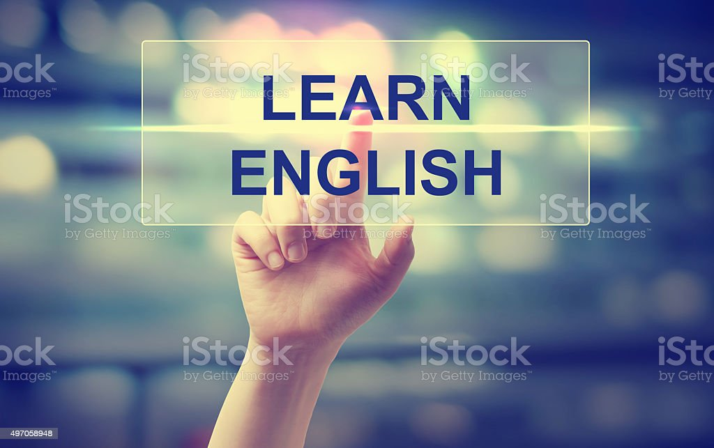Hand pressing Learn English stock photo