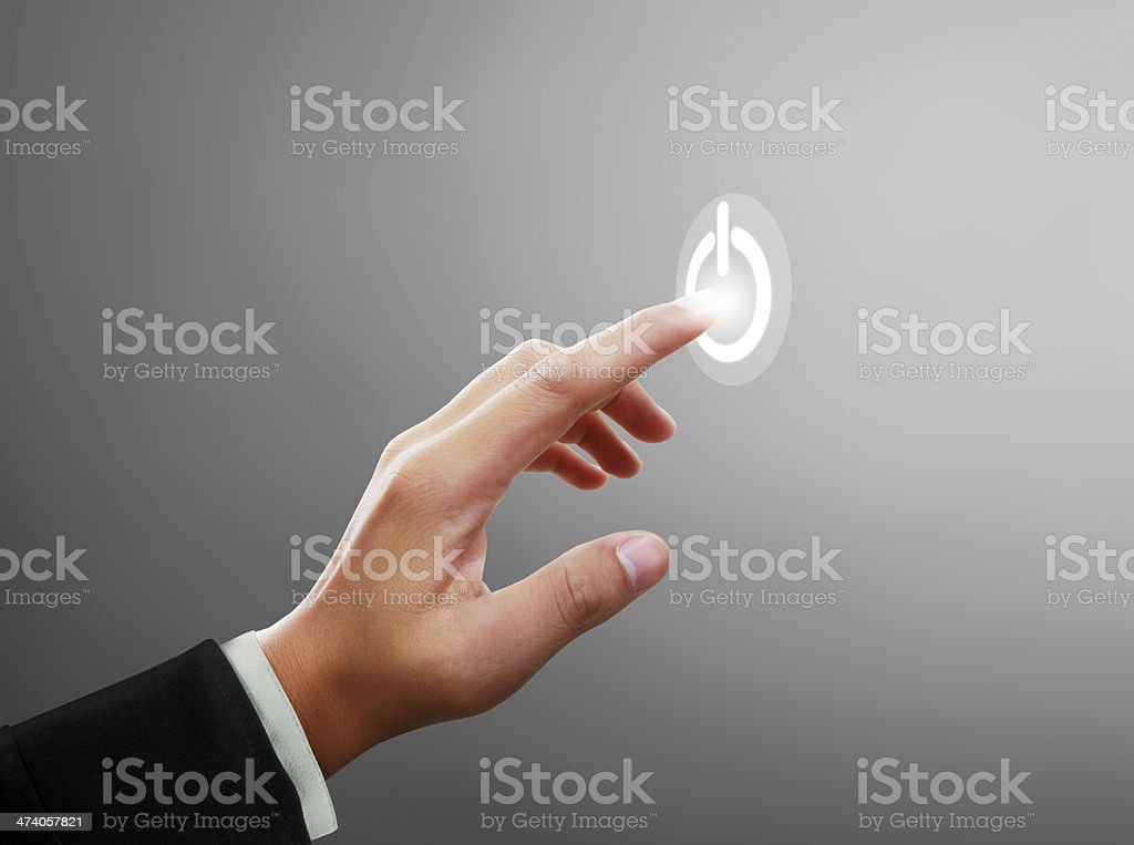 Hand pressing on and off button stock photo