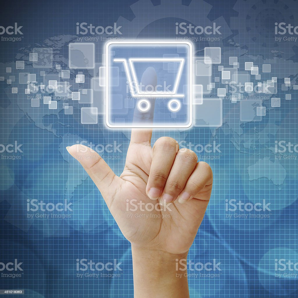 Hand pressing shopping cart icon on screen stock photo