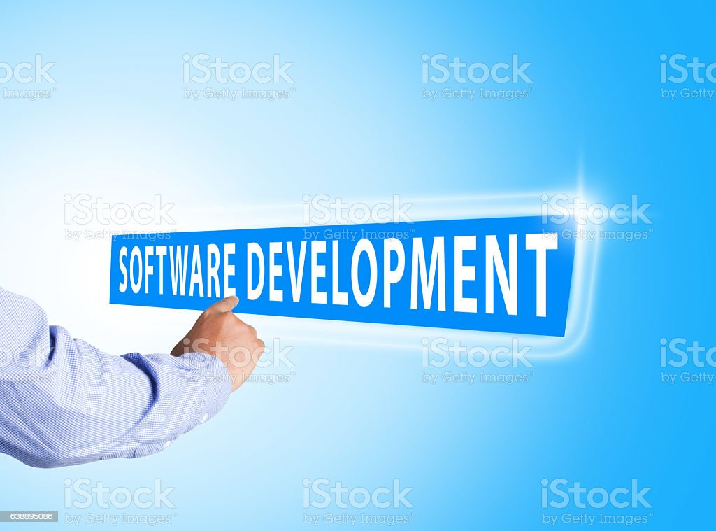 Hand pressing software development text on blue background stock photo
