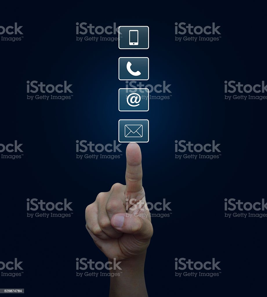 Hand pressing telephone, mobile phone, at and email buttons stock photo