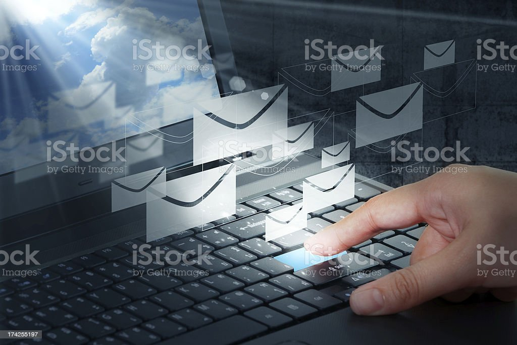 Hand pressing the enter button for email stock photo