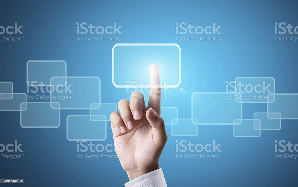 Hand pressing touchscreen button over blue background royalty-free stock photo