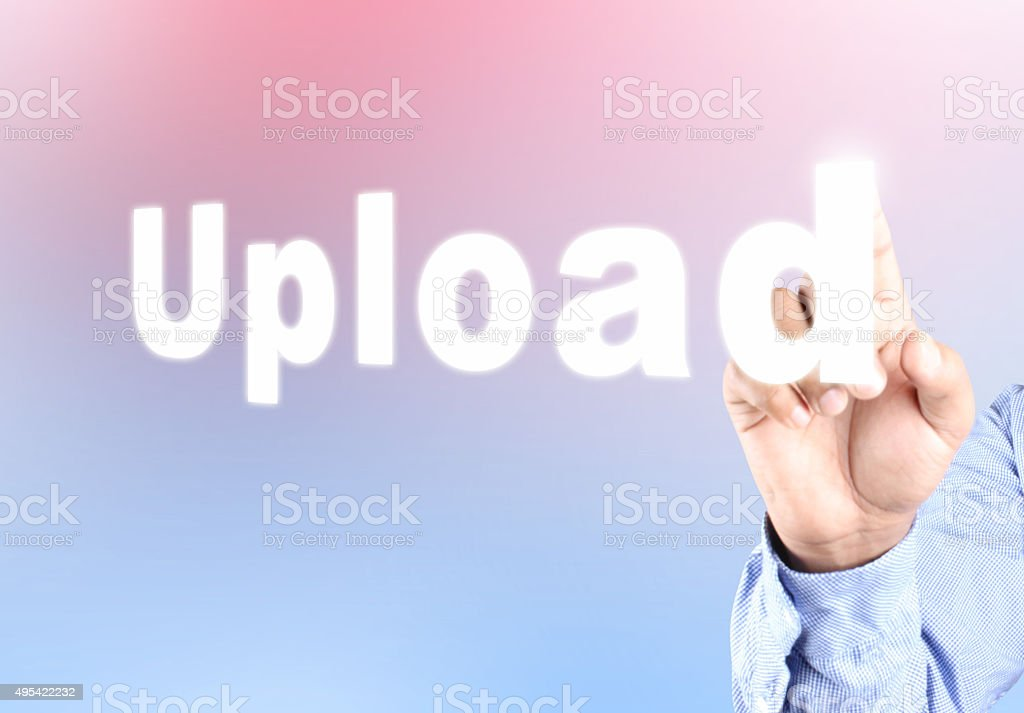 Hand pressing upload text on abstract background stock photo
