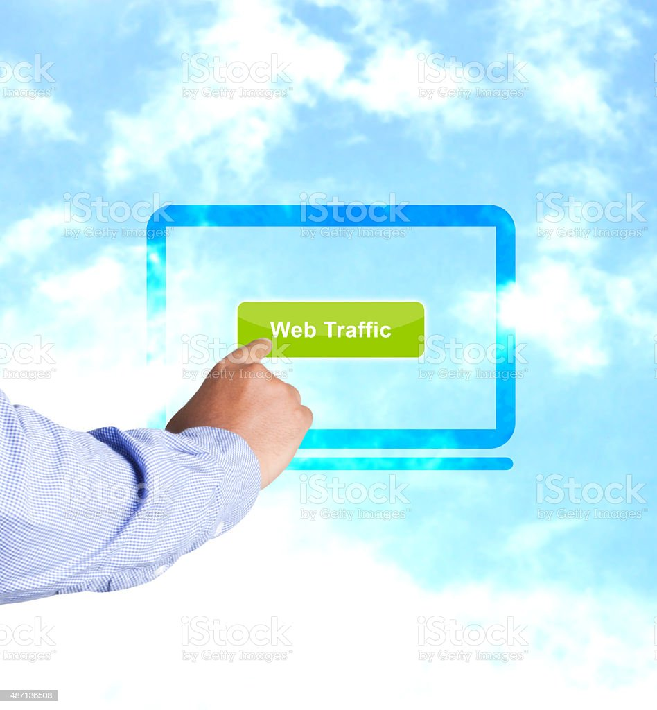 Hand pressing web traffic button stock photo