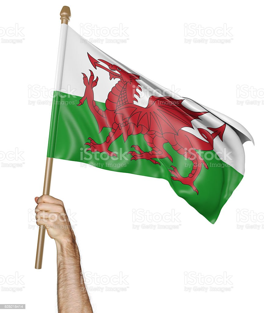 Hand proudly waving the flag of Wales stock photo