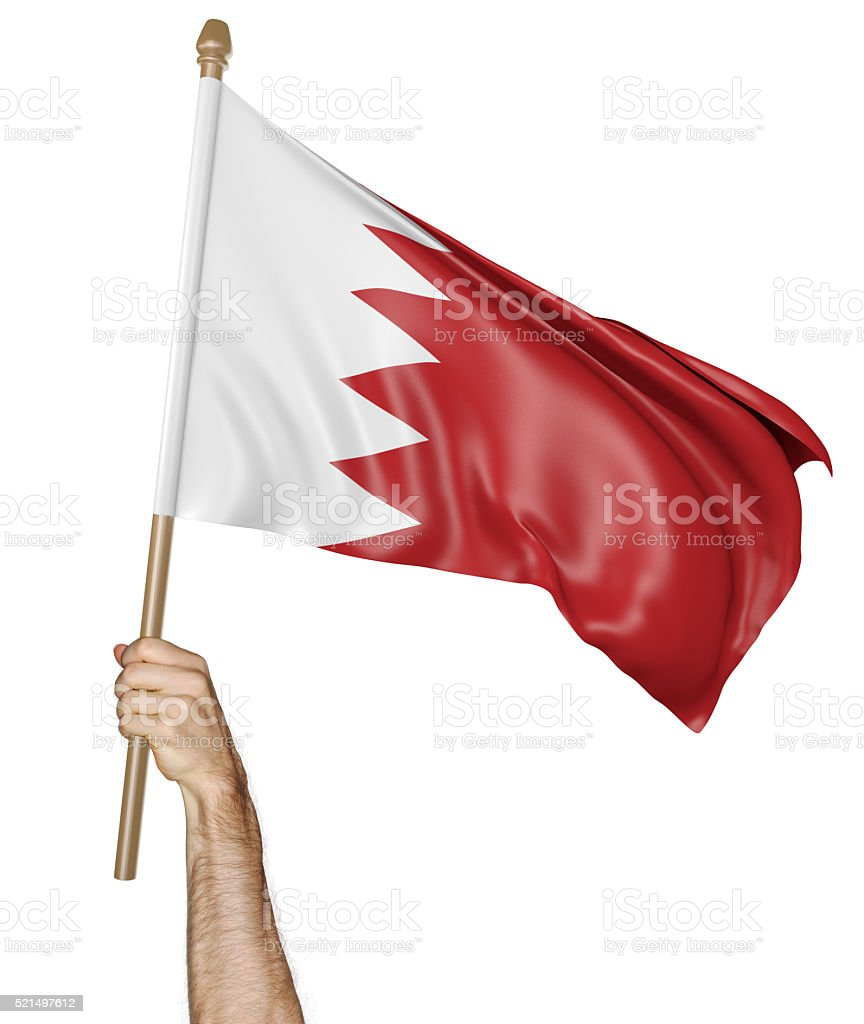 Hand proudly waving the national flag of Bahrain stock photo