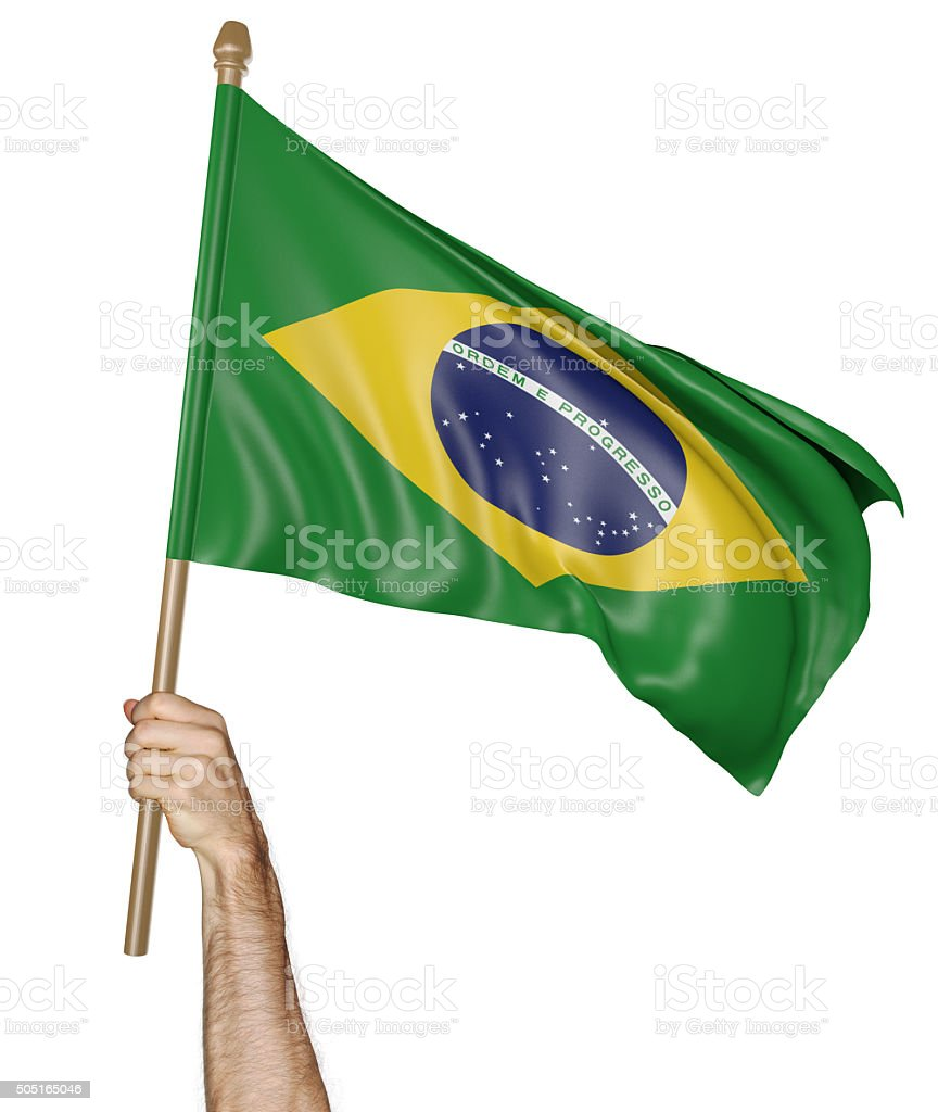 Hand proudly waving the national flag of Brazil stock photo