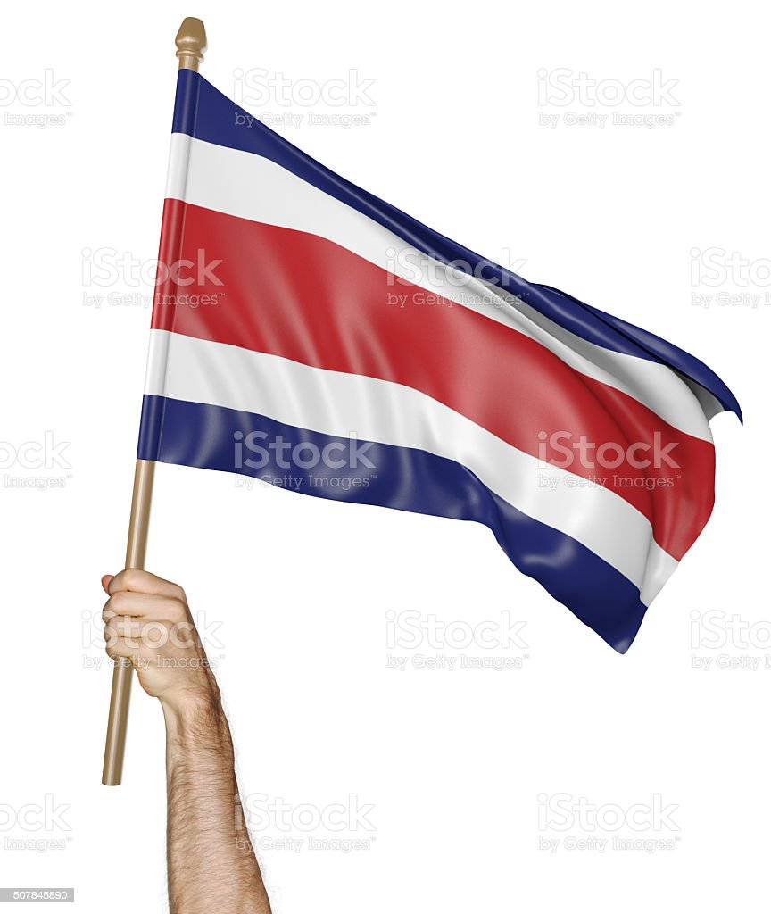 Hand proudly waving the national flag of Costa Rica stock photo