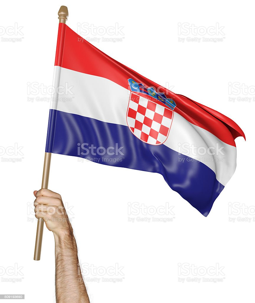 Hand proudly waving the national flag of Croatia stock photo