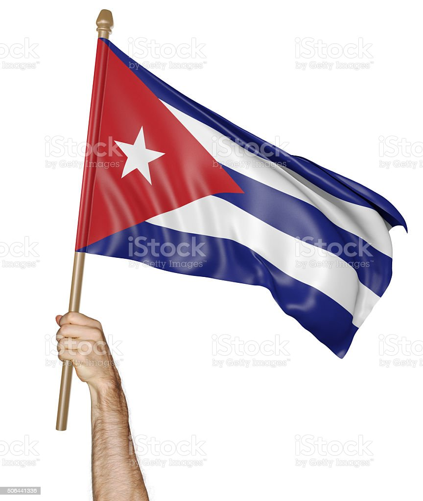Hand proudly waving the national flag of Cuba stock photo