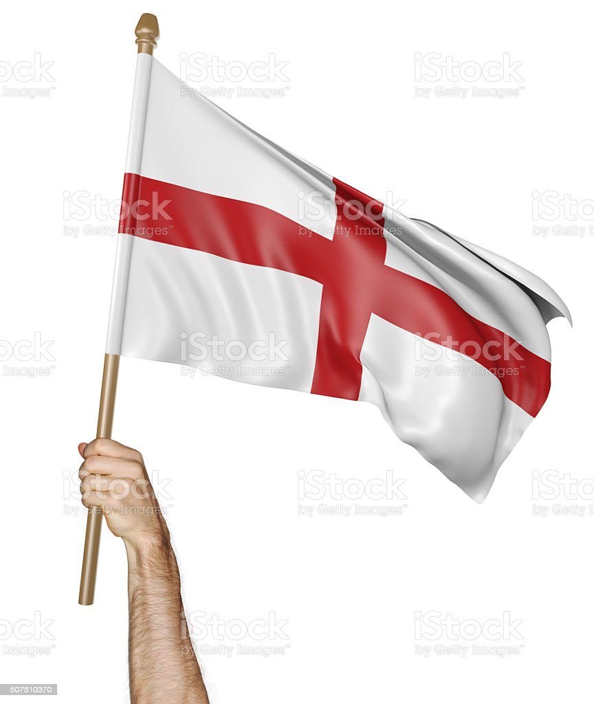 Hand proudly waving the national flag of England stock photo