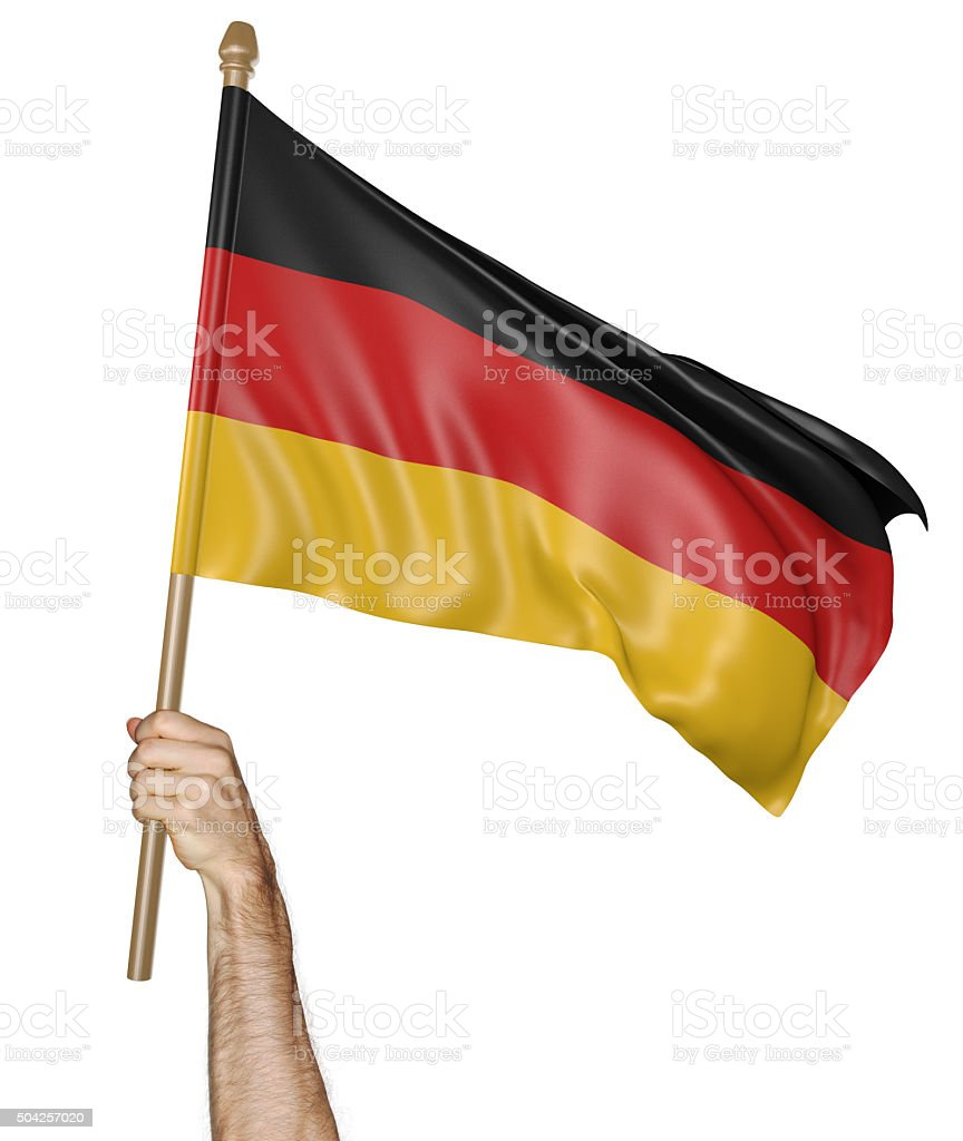 Hand proudly waving the national flag of Germany stock photo