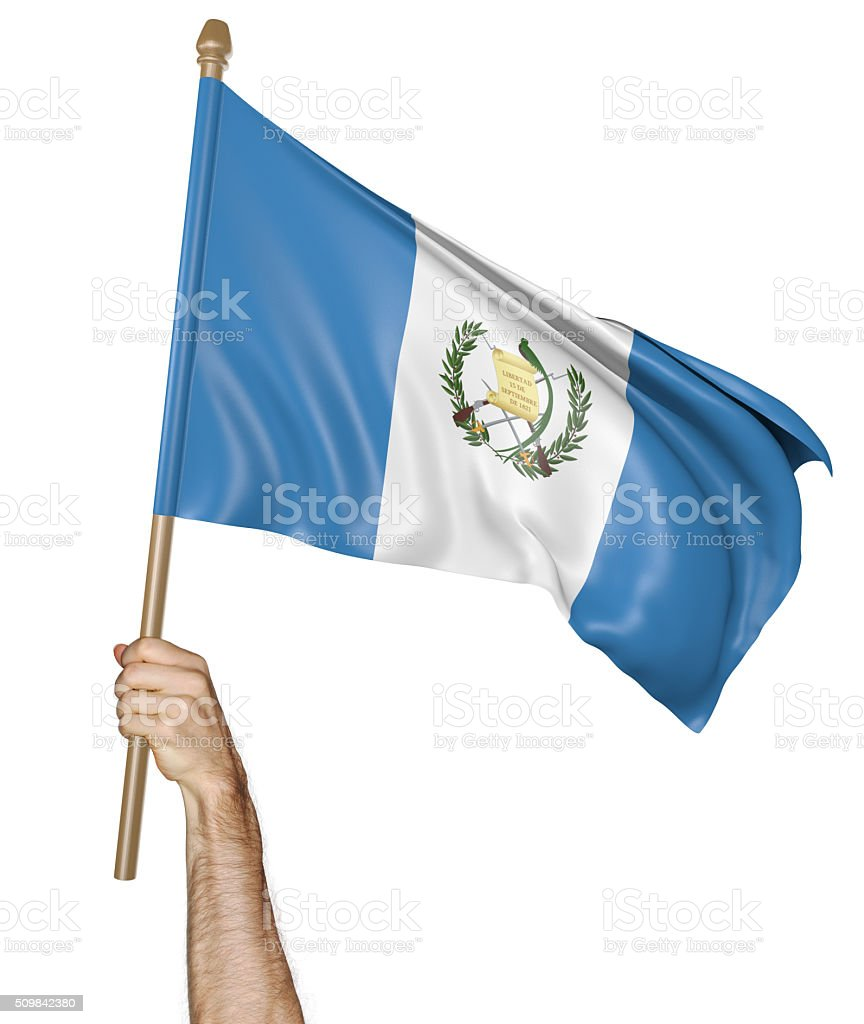 Hand proudly waving the national flag of Guatemala stock photo