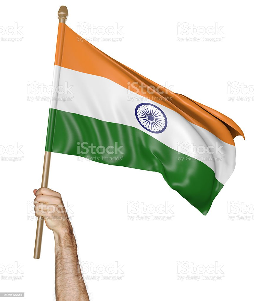 Hand proudly waving the national flag of India stock photo