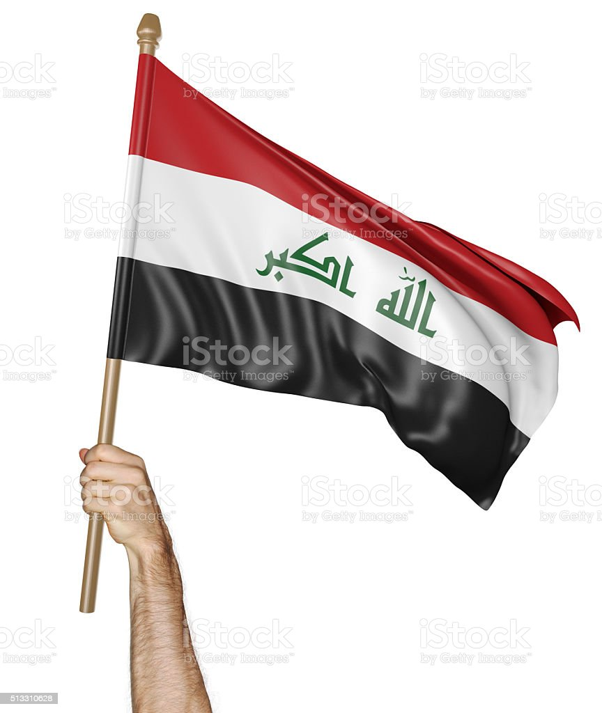 Hand proudly waving the national flag of Iraq stock photo