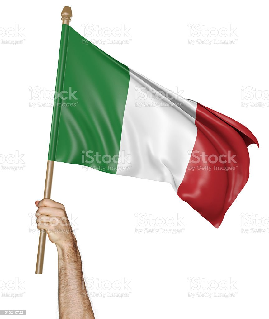 Hand proudly waving the national flag of Italy stock photo
