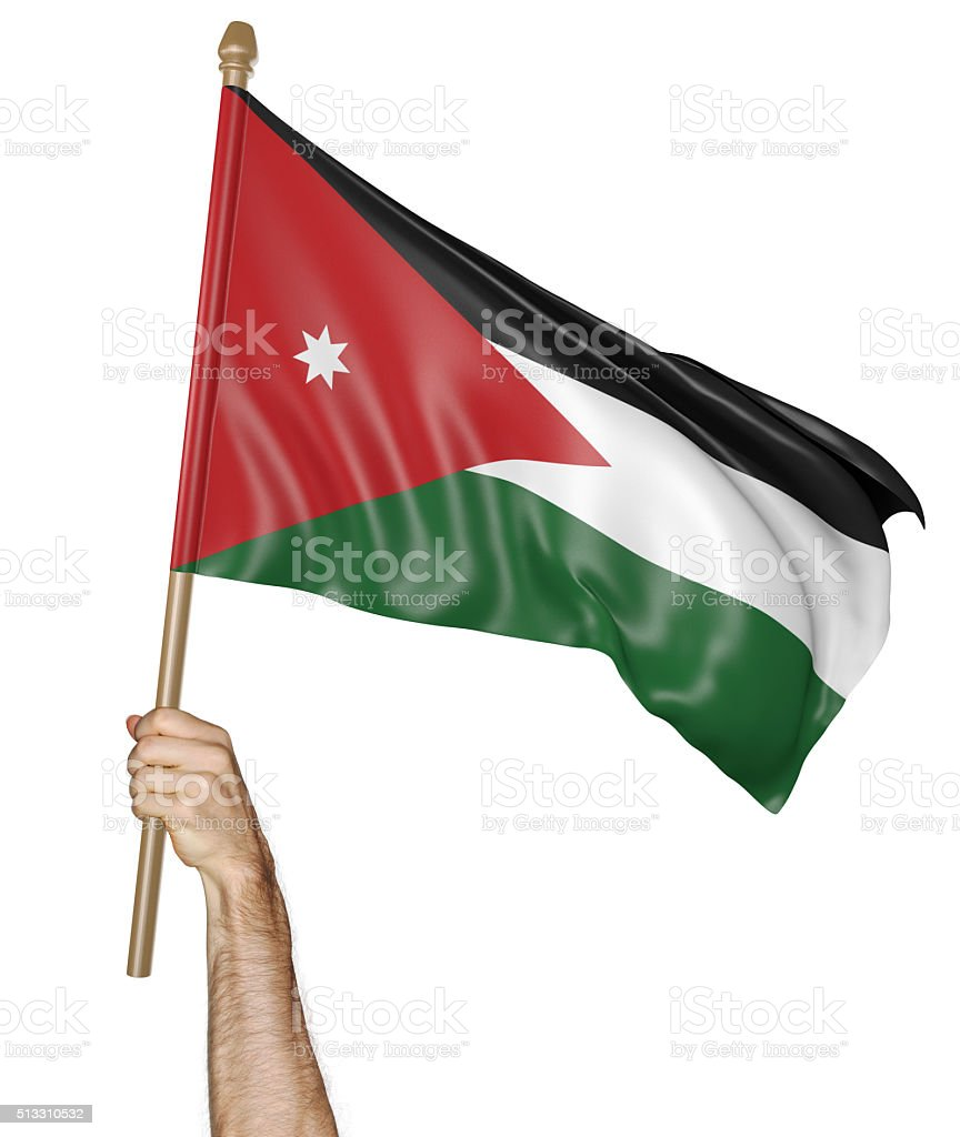 Hand proudly waving the national flag of Jordan stock photo