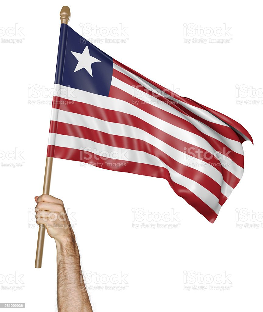 Hand proudly waving the national flag of Liberia stock photo