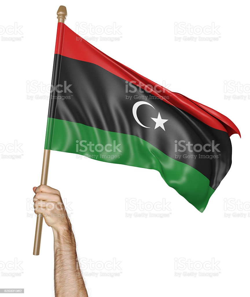 Hand proudly waving the national flag of Libya stock photo
