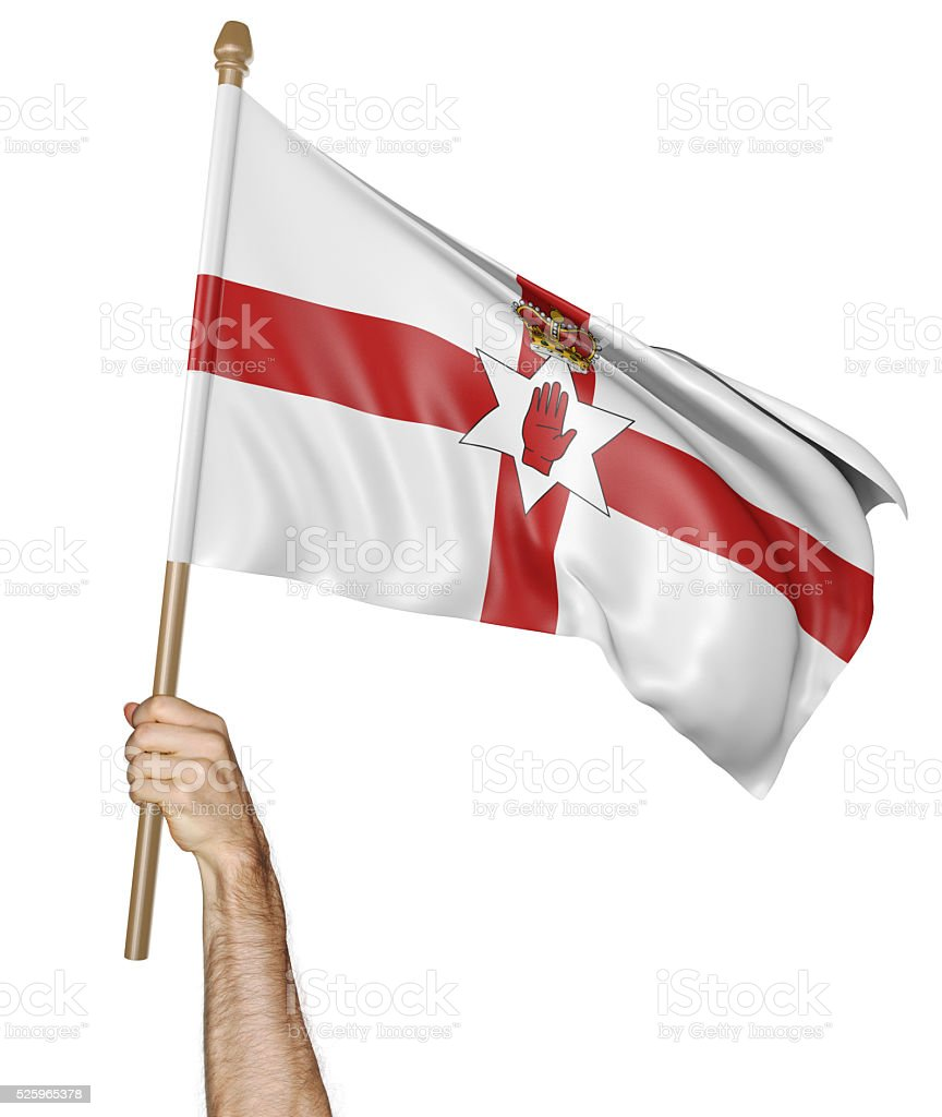 Hand proudly waving the national flag of Northern Ireland stock photo