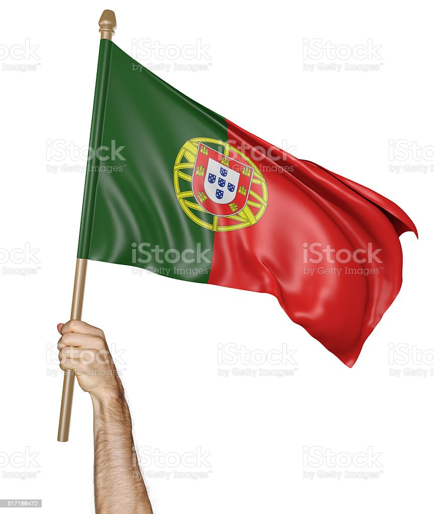 Hand proudly waving the national flag of Portugal stock photo
