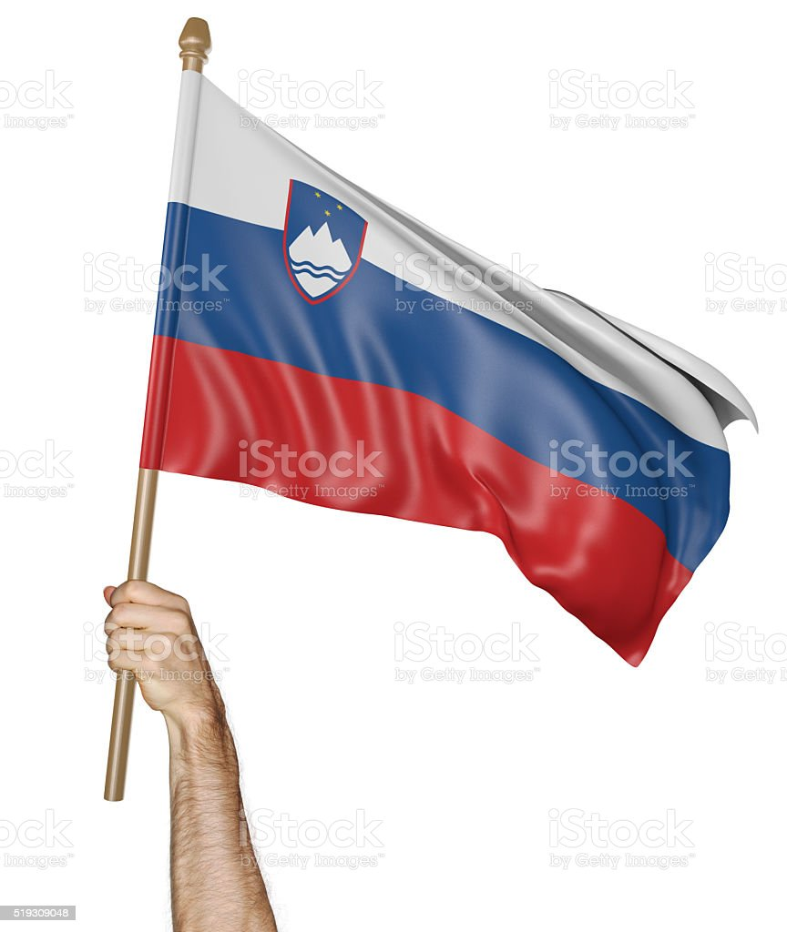 Hand proudly waving the national flag of Slovenia stock photo